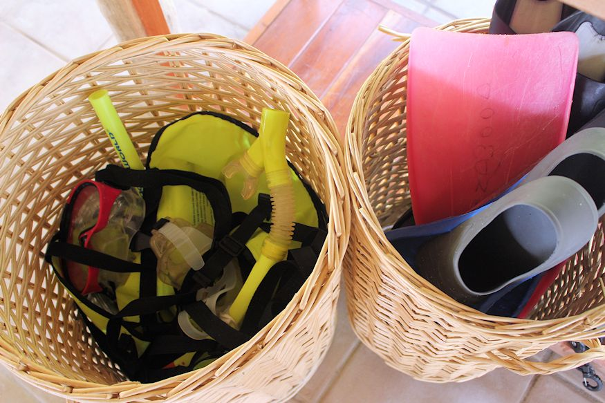 Snorkeling gear and fins in basket