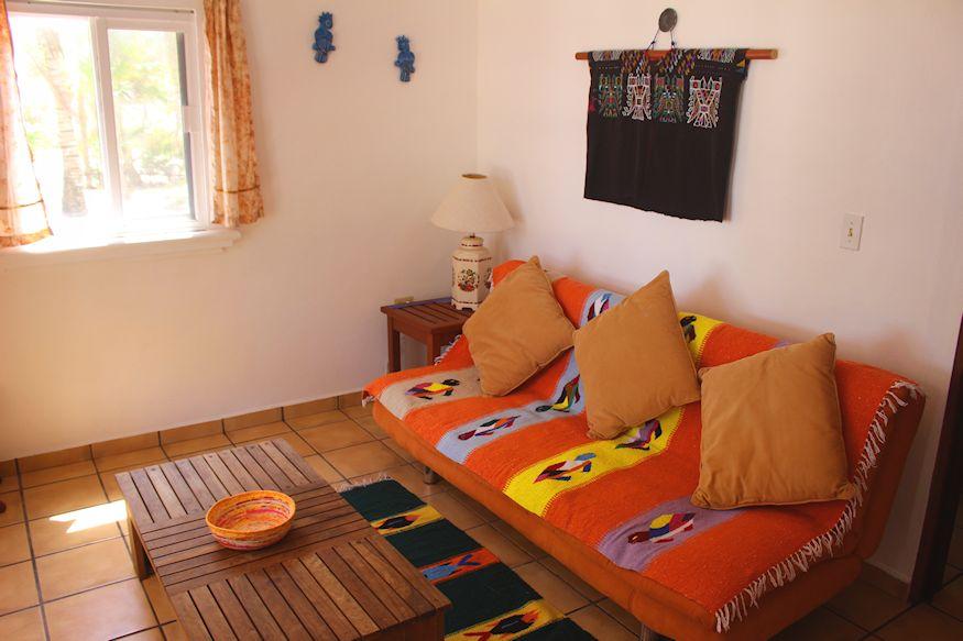 Orange futon on tile floor