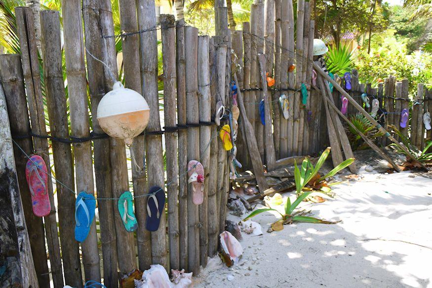 Fence with flip flops at Playa Sonrisa