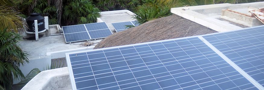 Solar panels in the sun on an Xcalak rooftop