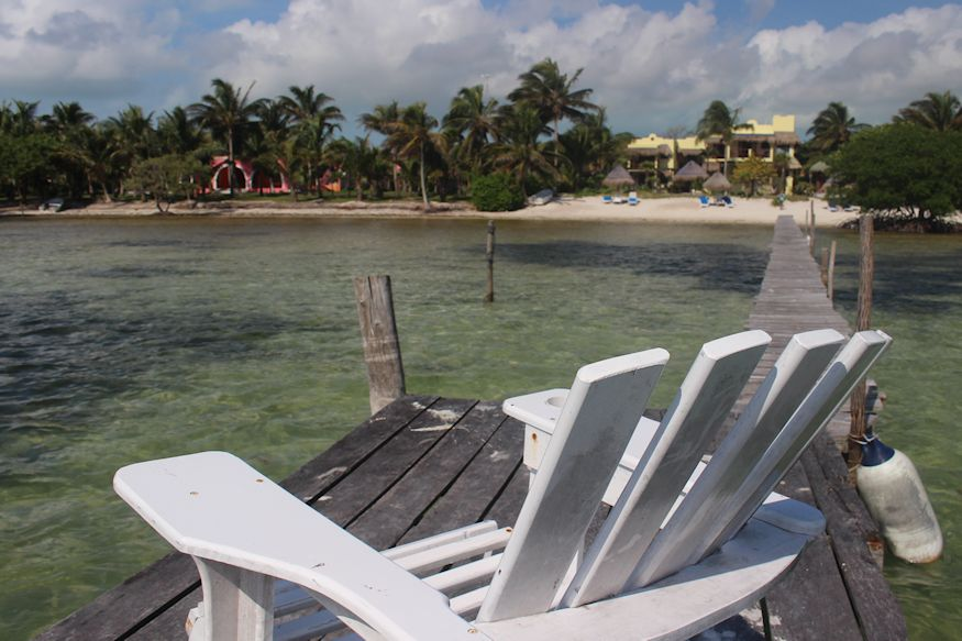 Chair on dock at Hotel Tierra Maya