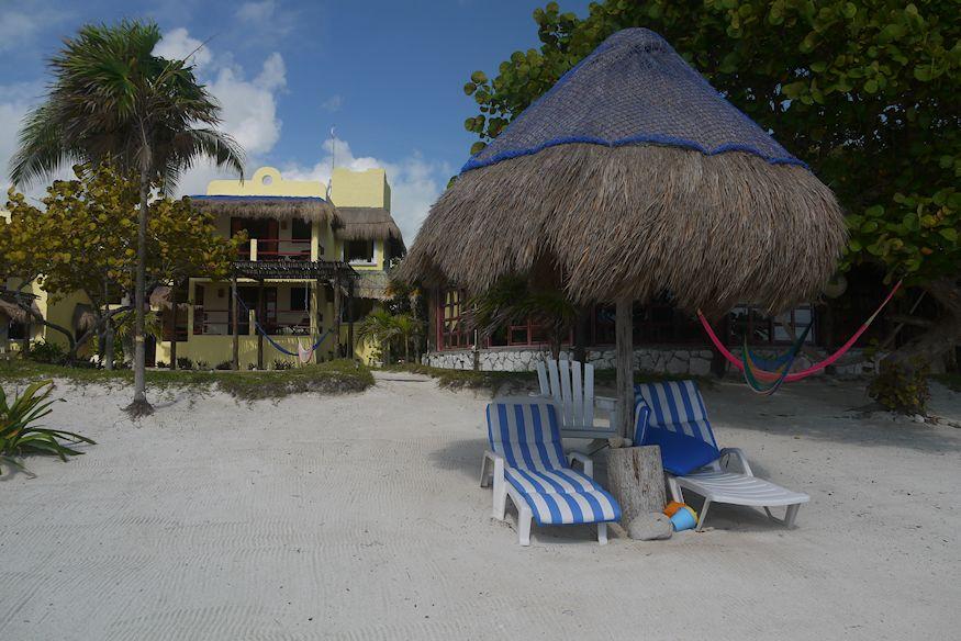 Palapa loungers Hotel Tierra Maya Beach