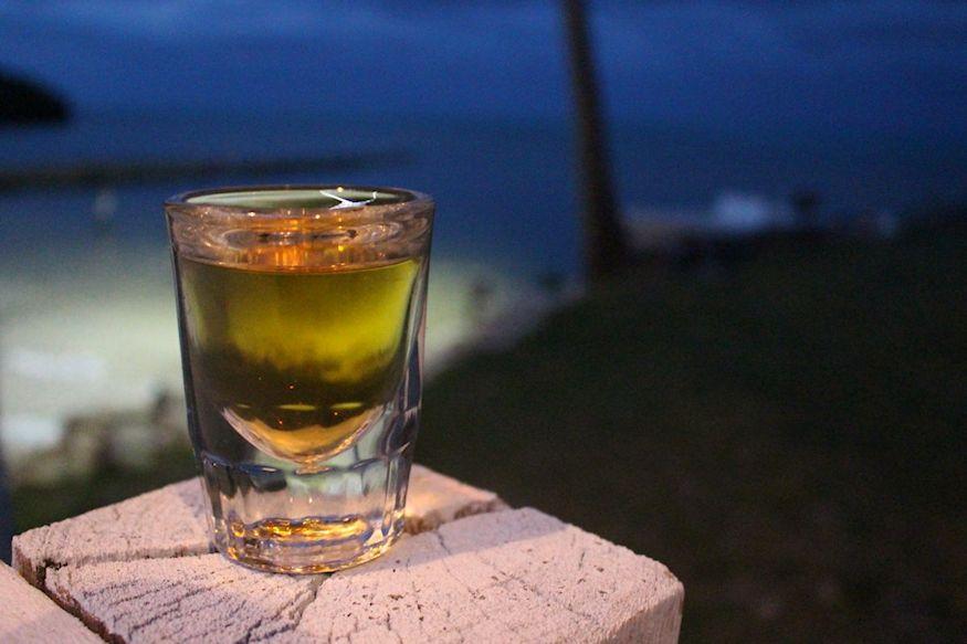 Whisky moonshine shot by Xcalak sea