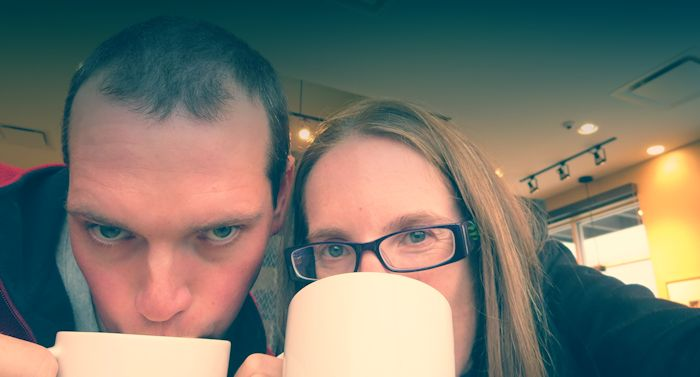 Tim and Heather over coffee mugs