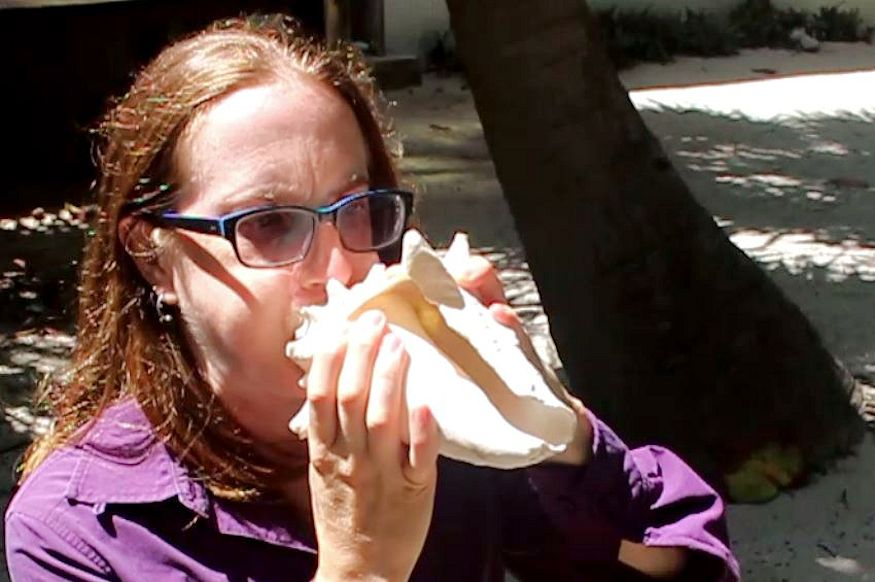 Blowing the conch shell horn like a champ