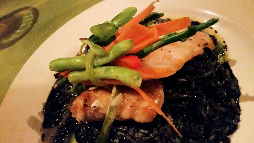 Local fish and squid ink risotto Leaky Palapa