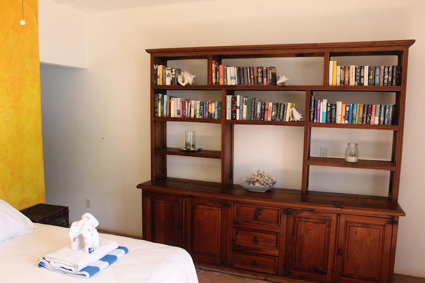 Bookcase and hotel bed
